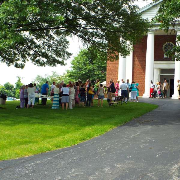 Members gathered on the lawn of the church after a service