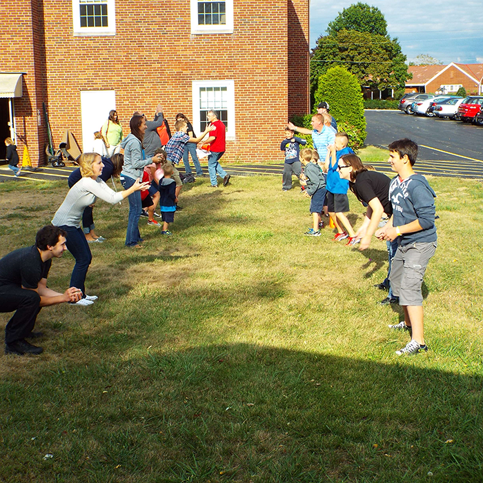 Youth group playing water balloons game