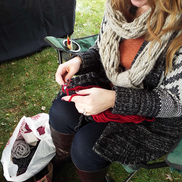 A seating girl working on a knitting project