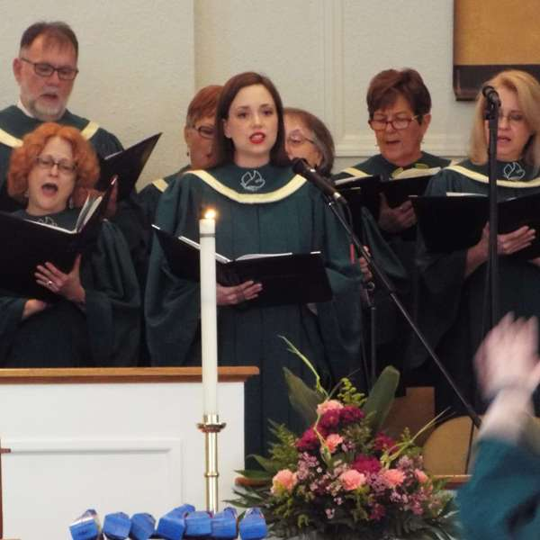 Choir members singing