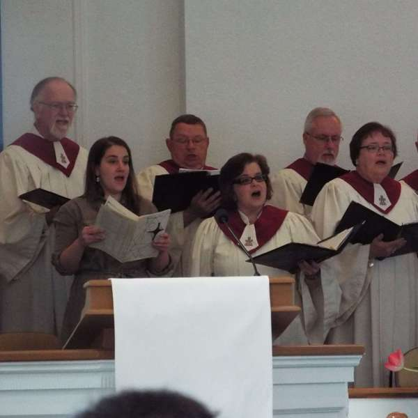 Close up of choir members singing