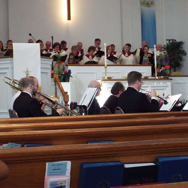 A brass band with the choir